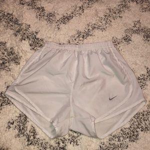White Nike shorts